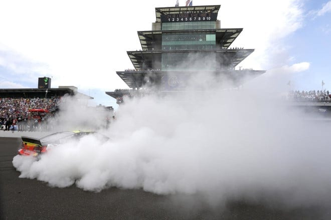 Jeff Gordon does a burnout after winning at Indianapolis Motor Speedway in 2014.
