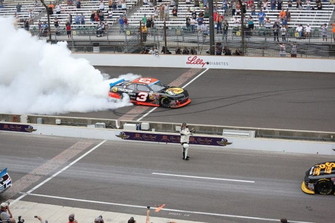 Ty Dillon burns them down after winning at Indianapolis Motor Speedway 2014 Nationwide Mike Neff