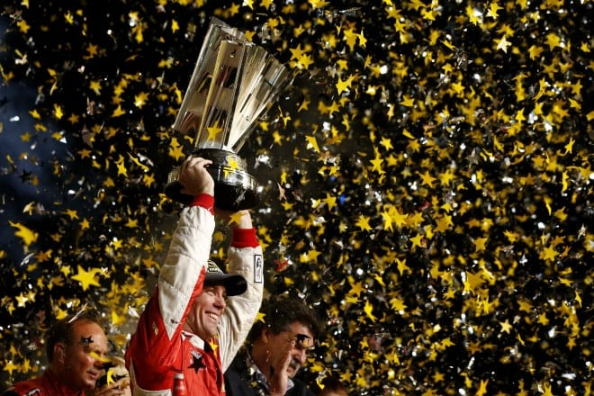 Kevin Harvick raises the Sprint Cup trophy after winning the 2014 title at Homestead Miami Speedway