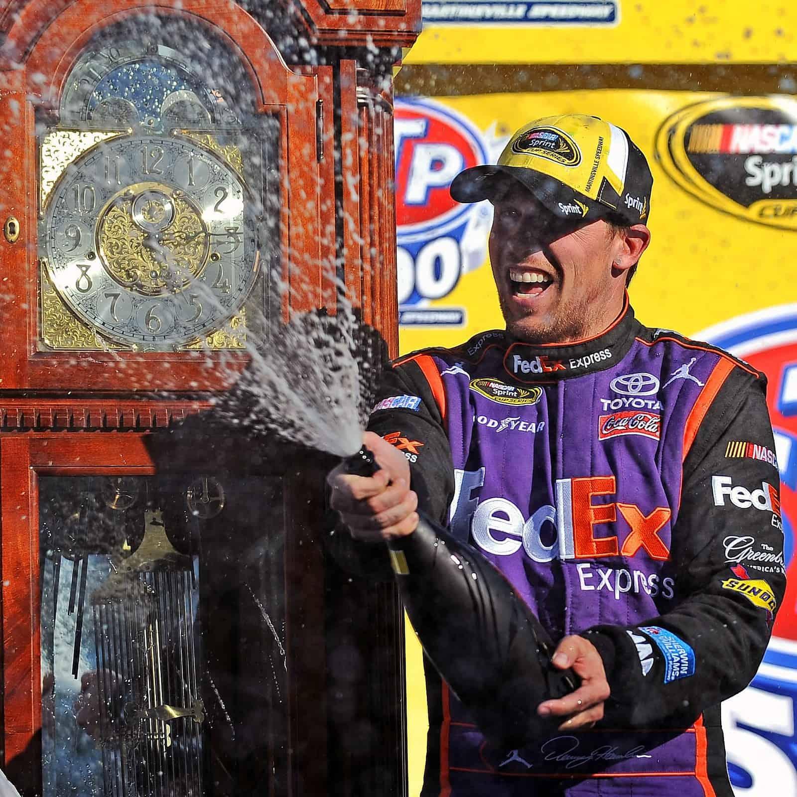 2015 Martinsville I CUP Denny HAmlin champagne credit NASCAR via Getty Images