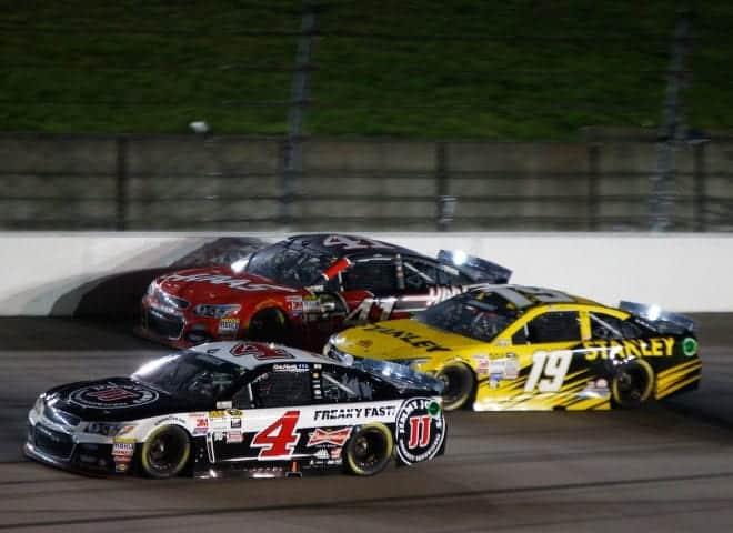 2015 Kansas I CUP Kevin Harvick Kurt Busch Carl Edwards racing credit NASCAR via Getty Images e1432079610693
