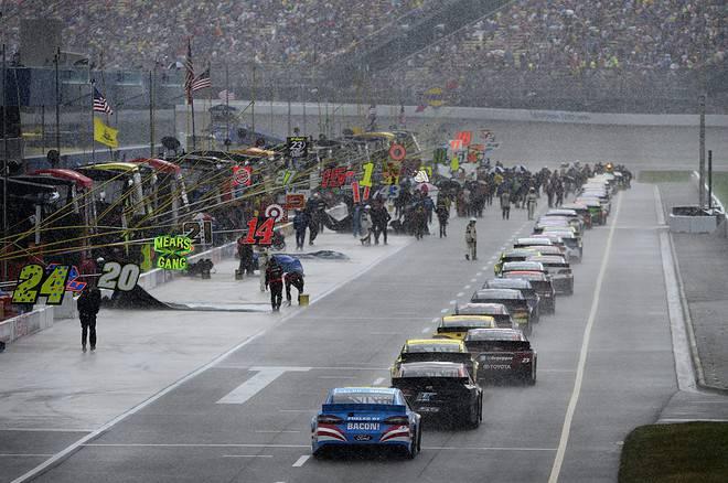 2015 Michigan International Speedway NSCS cars pit road rain credit nascar via getty images