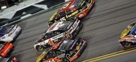 Tony Stewart, Kevin Harvick and Clint Bowyer race ofr position in the Coke Zero 400 at Daytona.