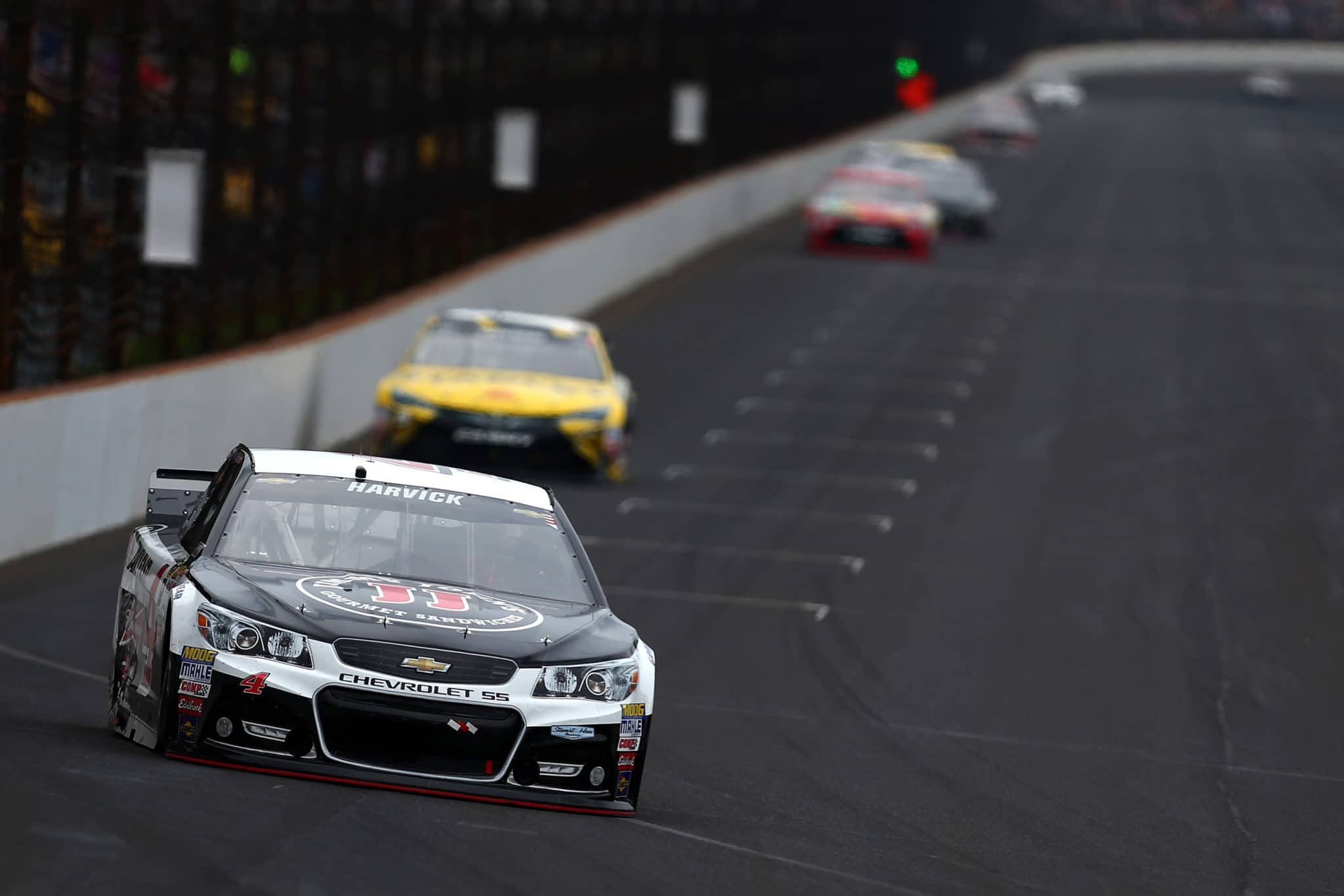 Kevin Harvick leads a pack of cars in the Jeff Kyle 400 at the Brickyard at Indianapolis Motor Speedway