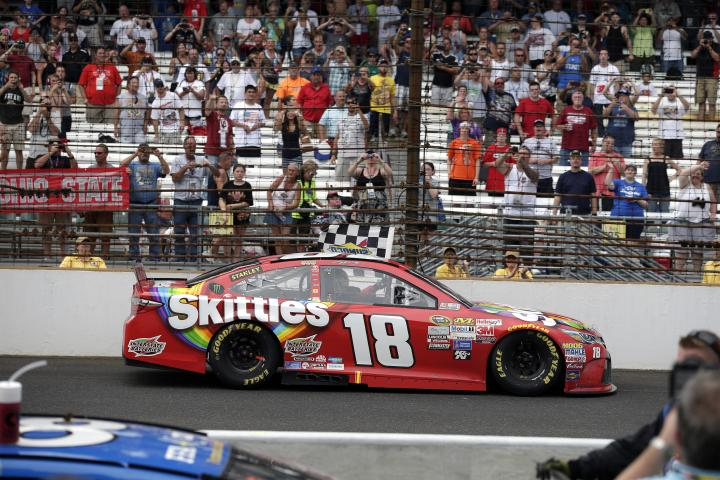 Kyle Busch celebrates his win at Indianapolis Motor Speedway