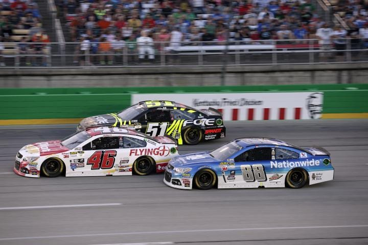 Michael Annett races Justin Allgaier and Dale Earnhart, Jr. in the 2015 Quaker State 400 at Kentucky Speedway