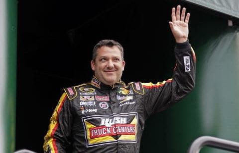 Tony Stewart waves to race fans during driver introductions at Kentucky Speedway.