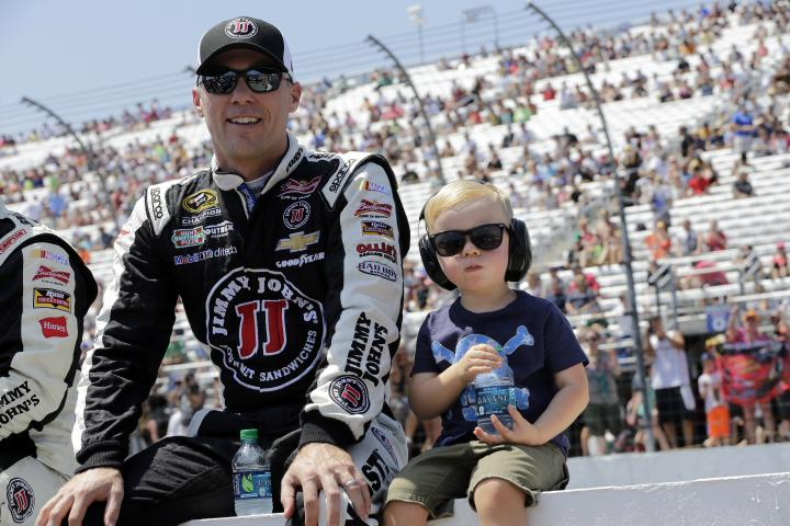 Kevin Harvick and son Keelan await the start fo the 5-hour Energy 301 at New Hampshire Motor Speedway