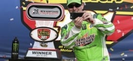 Kyle Busch snaps a photo in Victory Lane at New Hampshire Motor Speedway after winning the 5-hour Energy 301