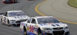 Tony Stewart and Brad Keselowski race during the 5-hour energy 301 at New Hampshire Motor Speedway