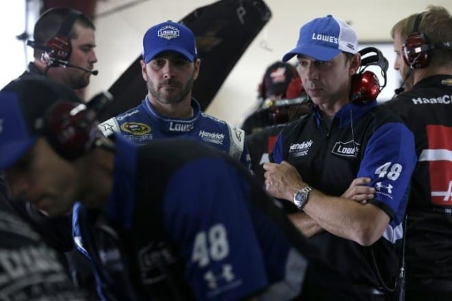 Jimmie Johnson and Chad Knaus in the garage at Michigan International Speedway during practice for the NASCAR Sprint Cup Pure Michigan 400