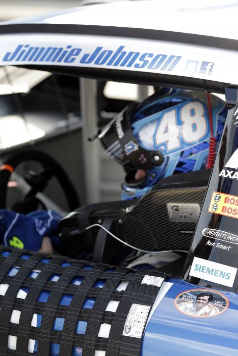 Jimmie Johnson sits in his No. 48 Lowe's Chevrolet during practice at Michigan International Speedway