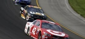 Lyle larson leads a pack of cars during the Pure Michigan 400 at Michigan International Speedway