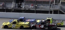 Kyle Busch edges ahead of Ryan Blaney in the 2015 Camping World Truck Series race at Michigan International Speedway