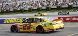 Joey Logano comes to pit road during the Windows 10 400 at Pocono Raceway