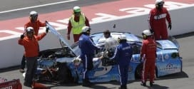 Kasey Kahne climbs from the No. 5 Chevy after a hard crash in the Windows 10 400 at Pocono Raceway