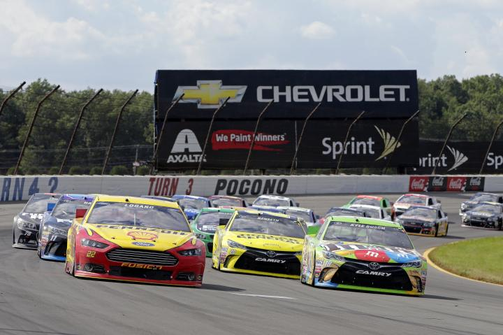 Kyle Busch and Joey Logano race for position in the Windows 10 400 at Pocono Raceway