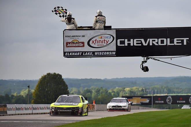 2015 Road America NXS Paul Menard checkered flag credit NASCAR via Getty Images