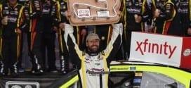 Paul Menard hoists the NASCAR XFINITY Series trophy at Road America August 29, 2015