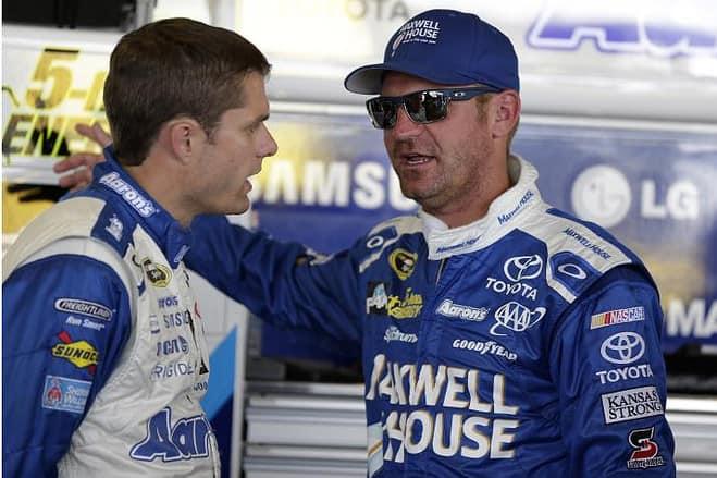 Michael Waltrip Racing teammates David Ragan and Clint Bowyer have a discussion during practice at Watkins Glen International