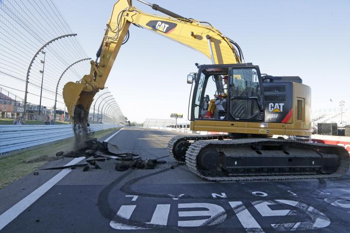 Joey Logano, winner of the Cheez-It 355 at the Glen, officially starts a repaving project for Watkins Glen International