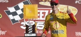 Joey Logano poses with the trophy after winning the Cheez-It 355 at the Glen at Watkins Glen International
