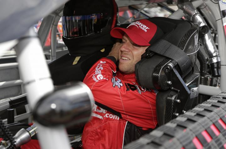 Regan Smith sits in his No. 7 Tax Slayer car during practice for the Zippo 200 at Watkins Glen International