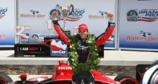 Justin Wilson celebrates his IndyCar victory at Watkins Glen in 2009