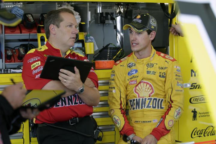 Joey Logano and crew chief Todd Gordon in conversation between practices for the myAFibRisk.com 400 at Chicagoland Speedway