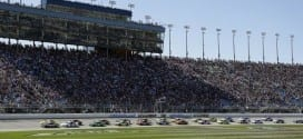 NASCAR Sprint Cup cars race past the grandstand at Chicagoland Speedway during the 2015 myAFibRisk.com 400