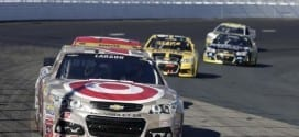 Kyle Lardon leads a pack of cars during the 2015 Sylvania 300 NASCAR Sprint Cup race at New Hampshire International Speedway