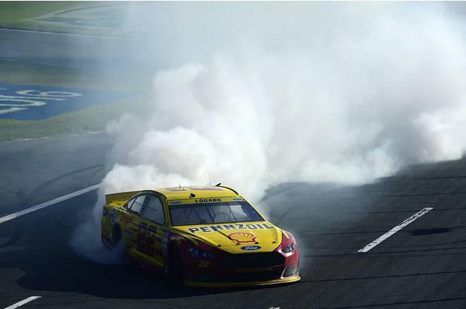 2015 Charlotte Motor Speedway Joey Logano burnout credit nascar via Getty Images