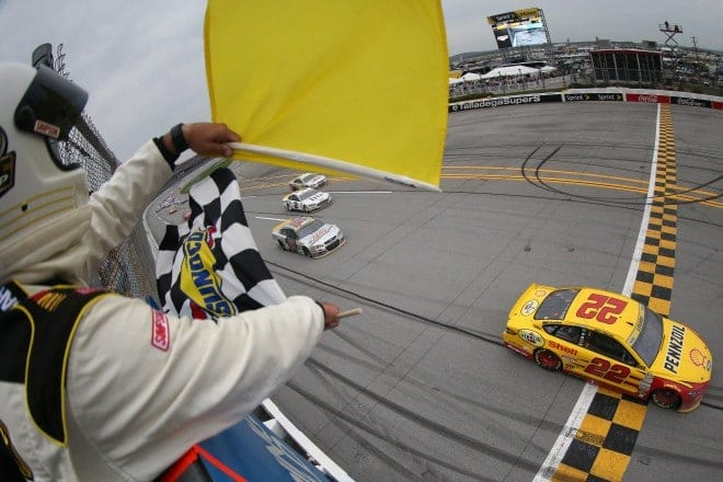 2015 Talladega Superspeedway NSCS Joey Logano checkered flag credit NASCAR via Getty Images