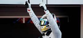 Lewis Hamilton celebrating his 2014 Russian GP win (credit: AP)