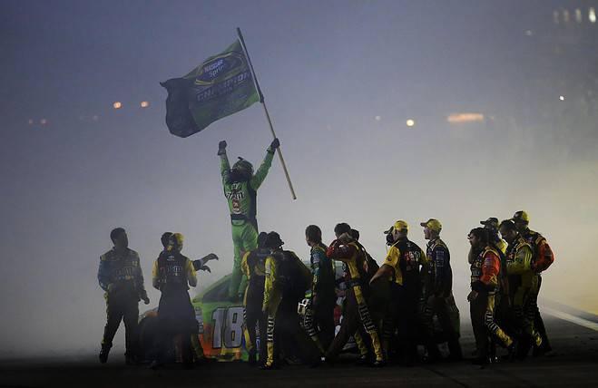2015 Homestead Miami Speedway NSCS Kyle Busch championship celebration frontstretch photo NASCAR via Getty Images