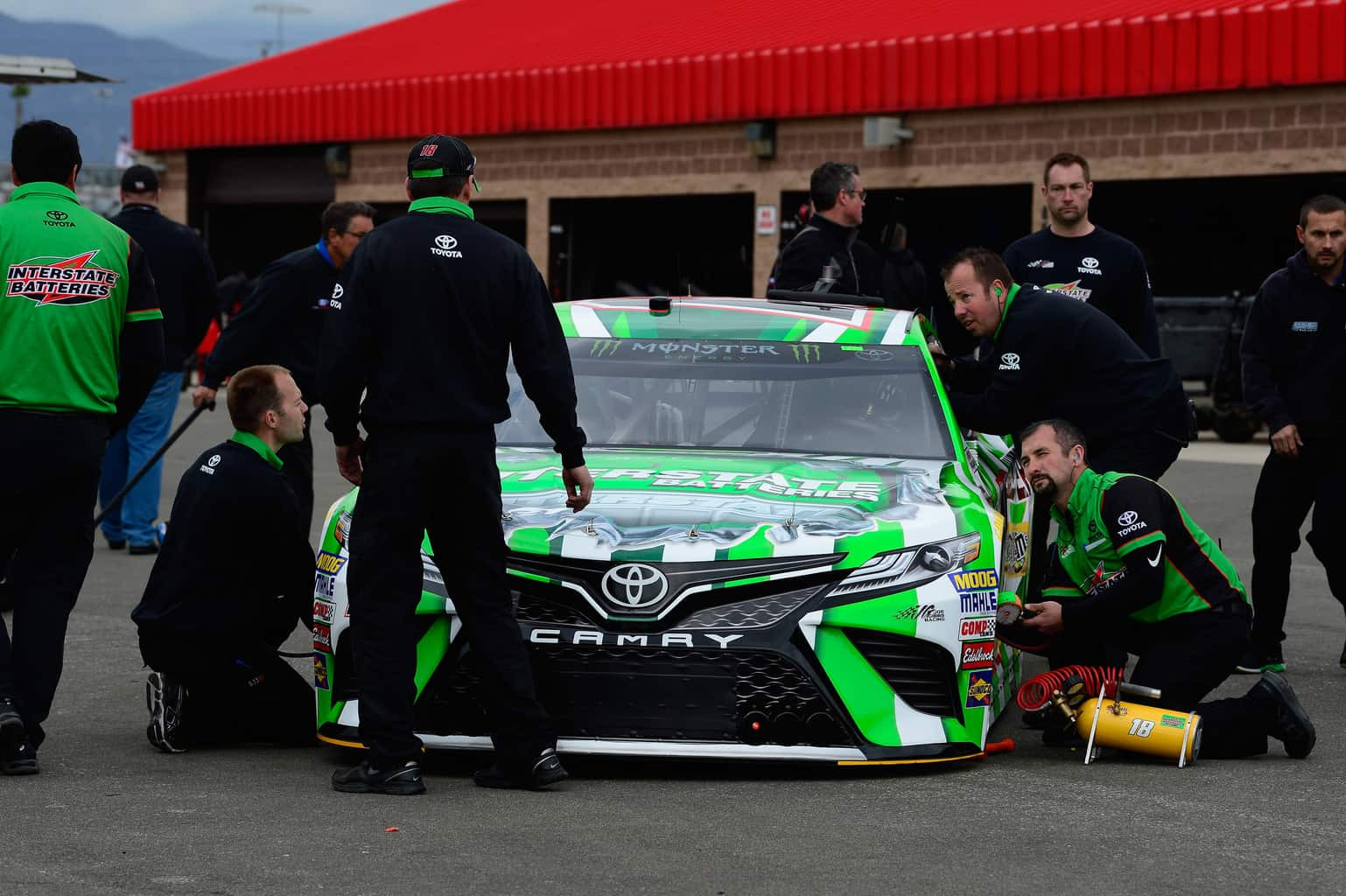 2018 Kyle Busch Crew MENCS Auto Club Speedway 2018 photo credit NASCAR via Getty Images