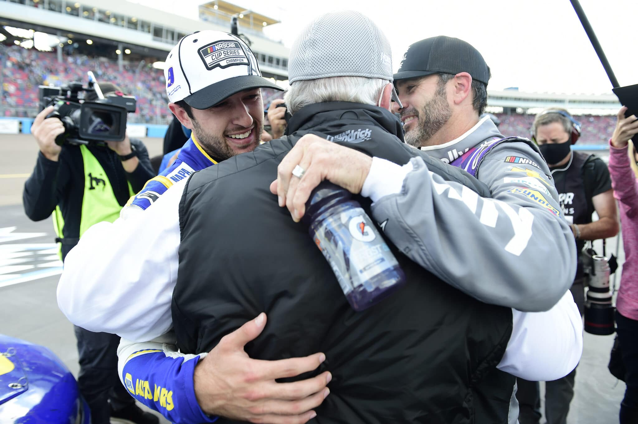 2020 Cup Phoenix Chase Elliott Rick Hendrick Jimmie Johnson Hug NASCAR via Getty Images scaled