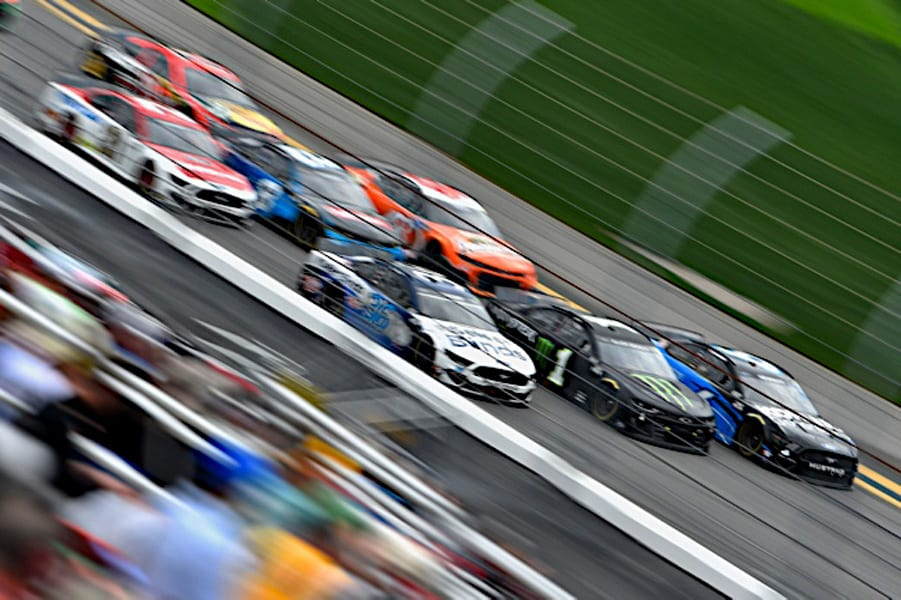 Cars speed past the grandstand in the 2021 Daytona 500 Photo: NKP
