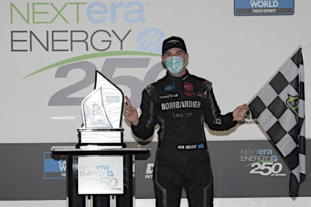 Ben Rhodes stands next to trophy after winning at Daytona in trucks Photo: Nigel Kinrade Photography