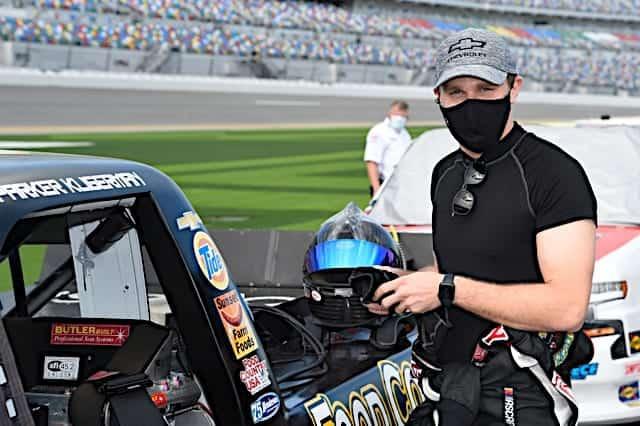 Parker Kligerman stands next to his truck at 2021 Daytona I race Photo NKP