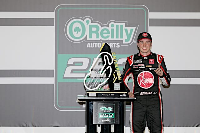 Christopher Bell poses with trophy after winning 2021 Daytona road Photo NKP