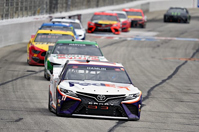 Denny hamlin leads the pack in NASCAR Cup Series action at Atlanta Motor Speedway. Photo: NKP