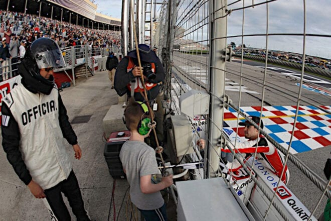 Ryan Blaney gives the checkered flag to a fan at Atlanta Motor Speedway. Photo NKP
