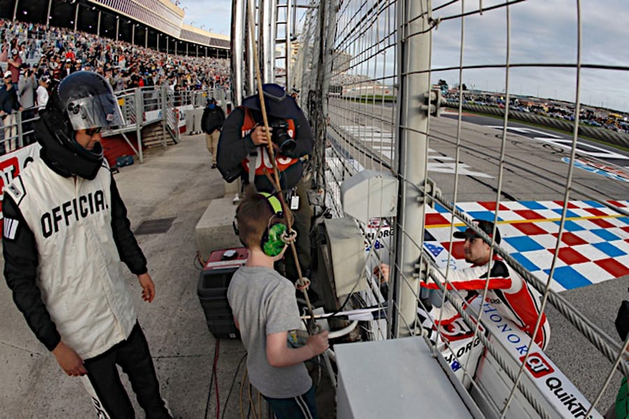 Ryan Blaney gives the checkered flag to a fan at Atlanta Motor Speedway. Photo NKP