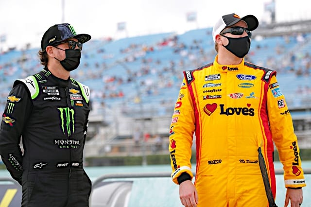 Kurt Busch and Michael McDowell standing before 2021 Homestead Cup race Photo NKP