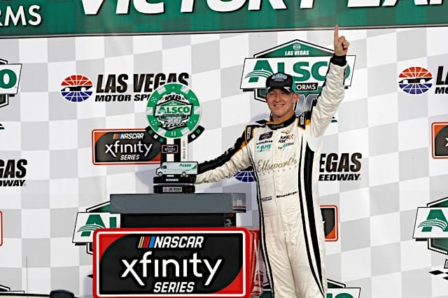 AJ Allmendinger celebrates in victory lane with trophy after winning at Las Vegas in Xfinity 2021 race Photo NKP