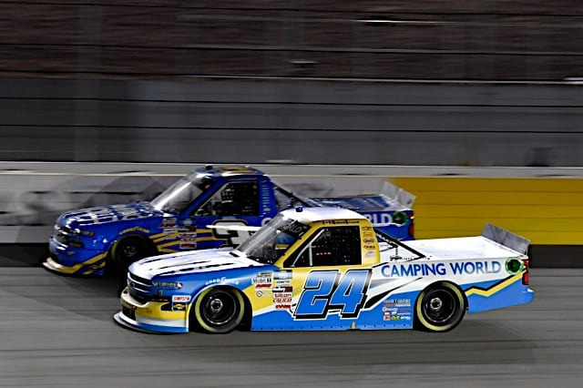 Raphael Lessard races with another truck adorned with Camping World colors in 2021 Las Vegas spring race Photo NKP