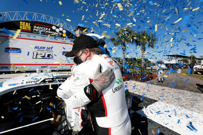 Robin Liddell and Frank DePew embrace in victory lane after winning the Alan Jay Automotive Network 120 at Sebring, 3/19/2021 (Courtesy of IMSA)