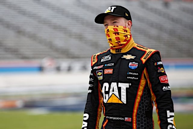 Tyler Reddick stands in CAT Richard Childress Racing firesuit at Texas fall Cup race 2020 NKP