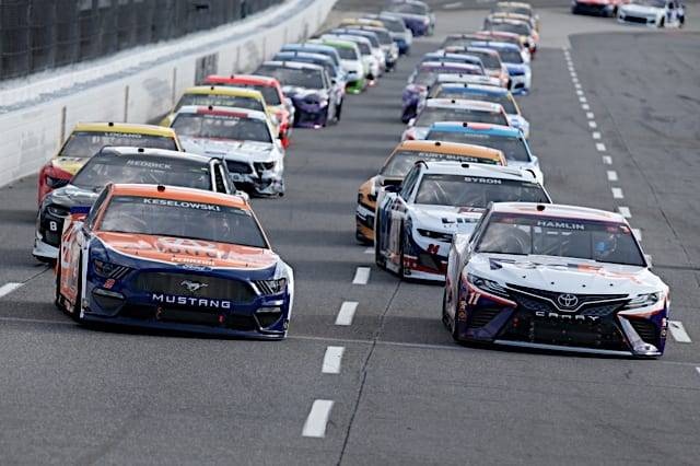 Brad Keselowski and Denny Hamlin lead the NASCAR field at Martinsville Speedway, April 2021. Photo: NKP